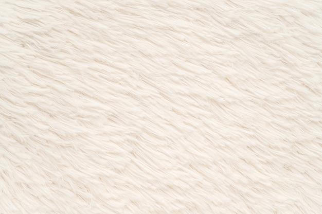 Abstrakter weißer pelzfußmattenbeschaffenheitshintergrund