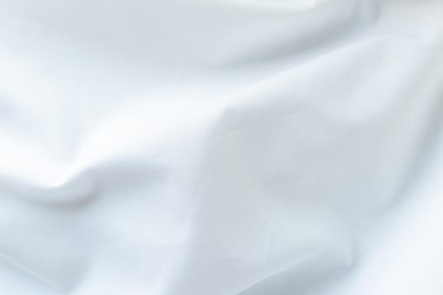 Abstrakter weißer stoffhintergrund, geknitterter weißer stoffhintergrund,