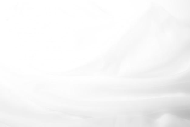 Abstrakter weißer stoffhintergrund mit weichen wellen. abstrakter hintergrund.