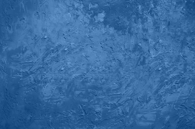 Abstrakter zementbetonhintergrund. grunge textur, tapete. trendige blaue und monochrome farbe. draufsicht, kopierraum.