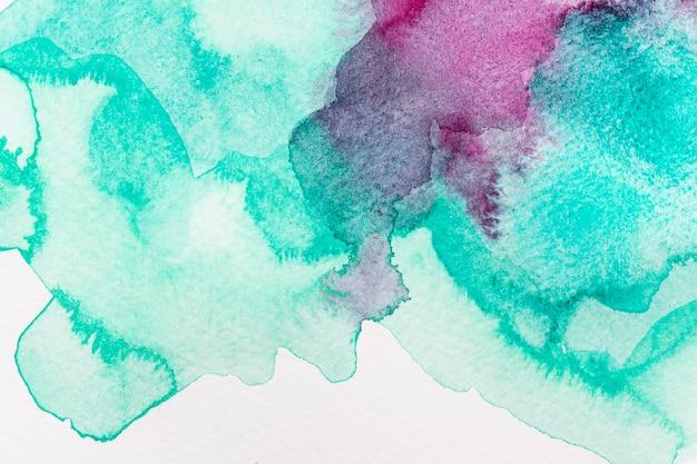 Abstraktes aquarellviolett und grüner hintergrund
