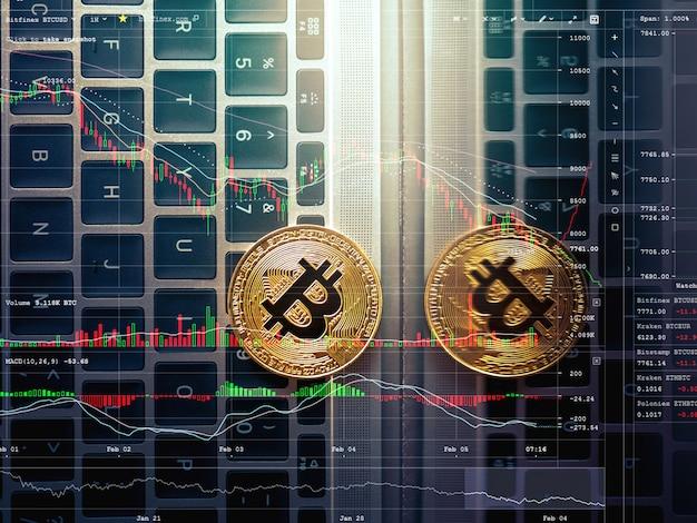 Abstraktes bitcoin auf laptoptastatur bitcoin handelshintergrund