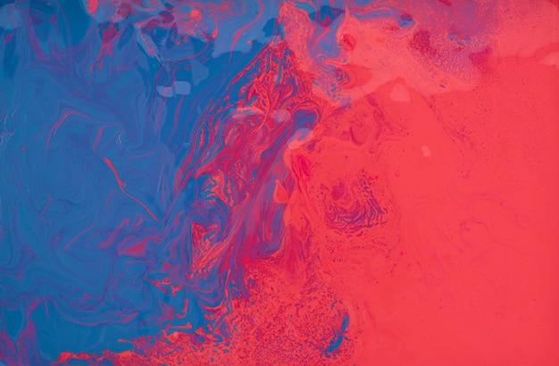 Abstraktes blau mit rotem wasserfarbbeschaffenheitshintergrund