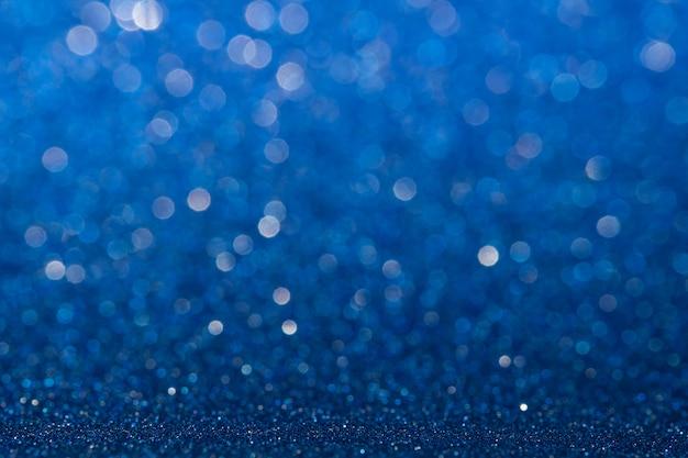 Abstraktes blaues funkelndes glitzerwand- und bodenperspektivenhintergrundstudio mit unschärfebokeh