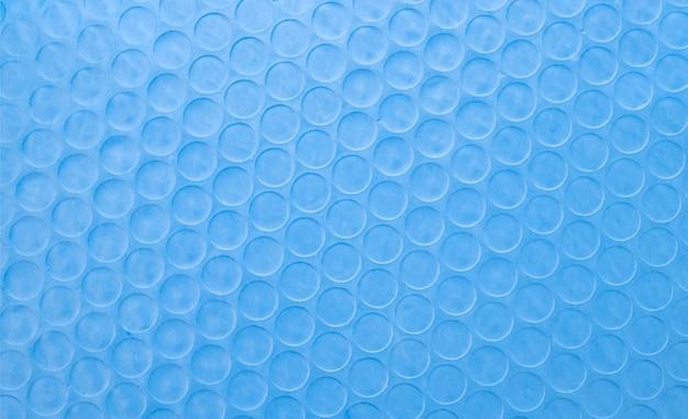 Abstraktes blaues papier mit kreislinienbeschaffenheitshintergrund