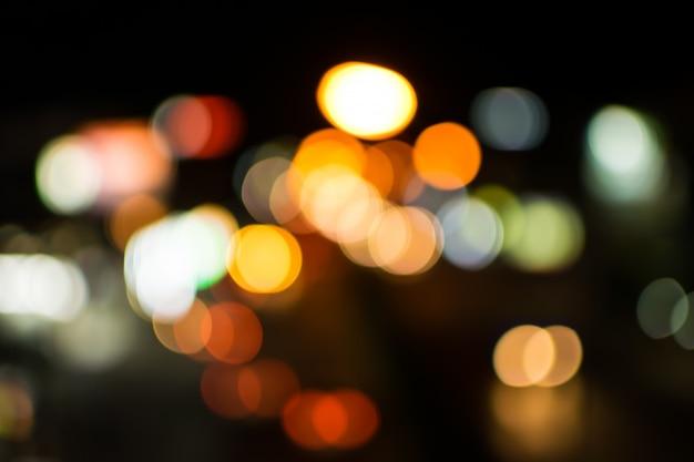 Abstraktes bokeh der unschärfe beleuchtet hintergrund