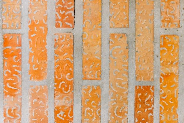 Abstraktes design auf backsteinmauerhintergrund