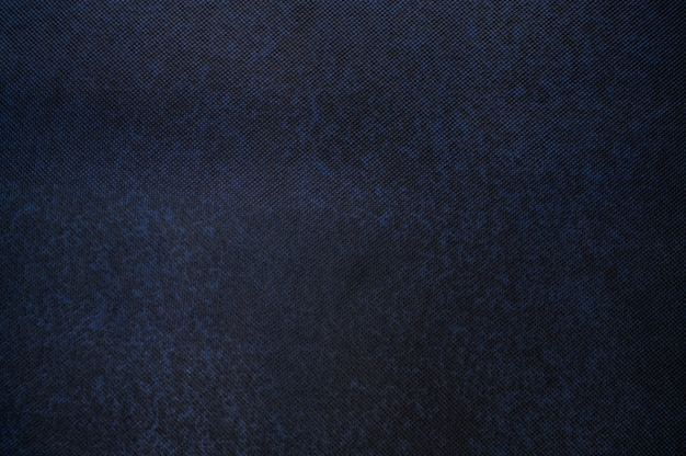 Abstraktes dunkelblau mit schwarzem flecktexturhintergrund