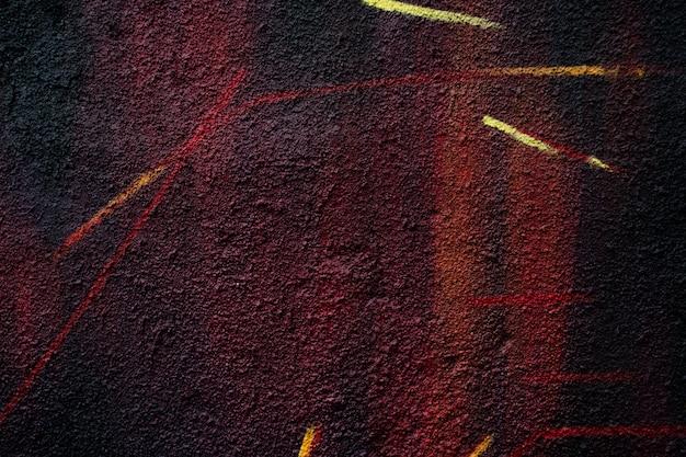 Abstraktes farbmuster auf dem asphalt. körniger hintergrund.