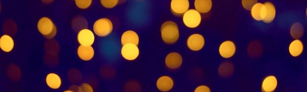 Abstraktes gelbgold-bokeh. hintergrundunschärfe, banner. weihnachtsbeleuchtung
