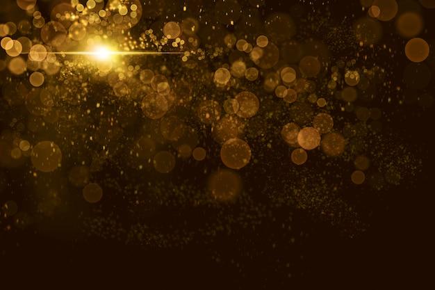 Abstraktes goldbokeh mit partikelhintergrund