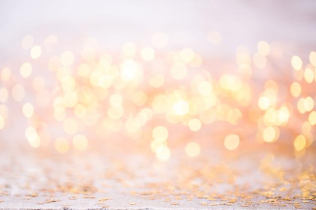 Abstraktes goldbokeh. weihnachts- und neujahrsthemahintergrund.