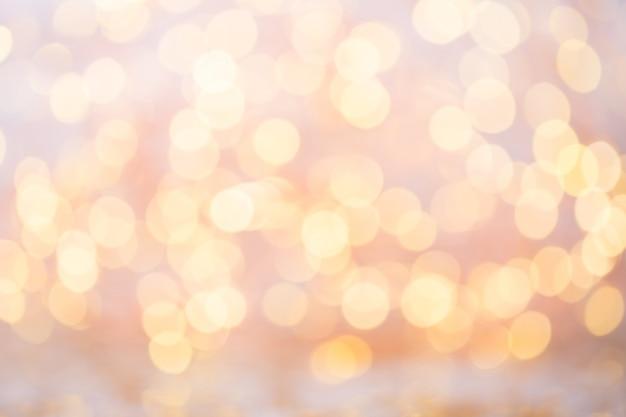 Abstraktes goldbokeh. weihnachts- und neujahrsthemaoberfläche.