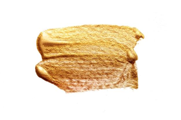 Abstraktes goldenes abstrichbürstenacryl in der schmutzart auf weiß