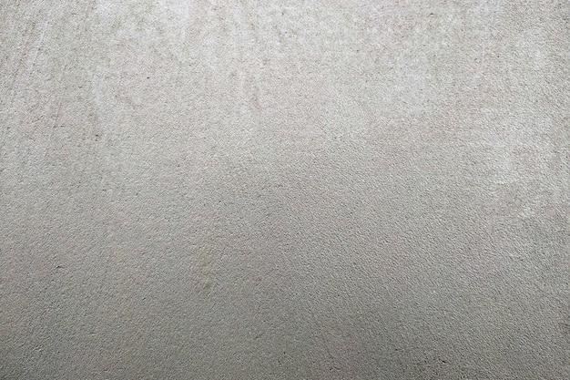 Abstraktes graues strukturiertes backgroung. wand bedeckt mit zementmörtel.