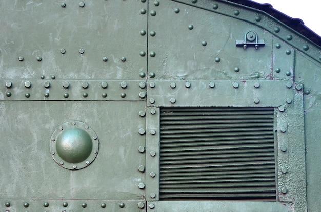 Abstraktes grünes industrielles metall gemasert mit nieten und bolzen