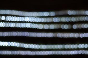 Abstraktes kreisförmiges bokeh des Lichtes verwischt