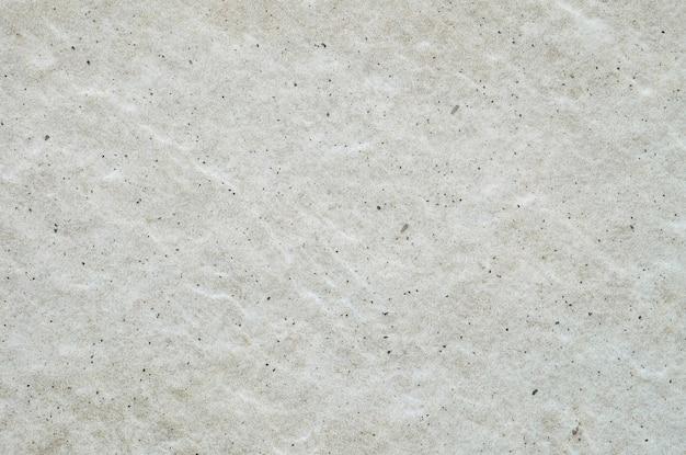Abstraktes marmormuster der nahaufnahme an der grauen marmorsteinwand maserte hintergrund