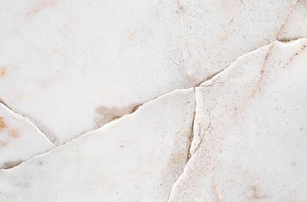 Abstraktes marmoroberflächenmuster der nahaufnahme am gebrochenen marmorsteinboden-beschaffenheitshintergrund