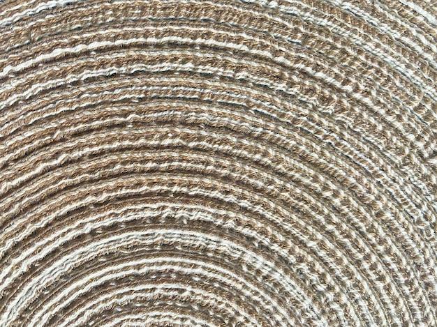 Abstraktes naturgeflecht aus weinrebe, stroh, baumwollhintergrund