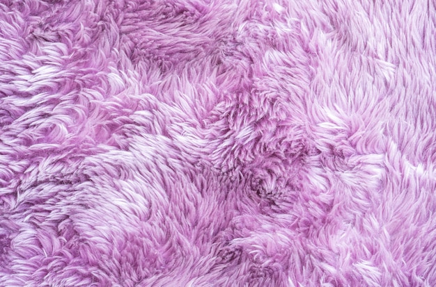 Abstraktes oberflächenmuster der nahaufnahme am purpurroten gewebeteppich am boden des hausbeschaffenheitshintergrundes