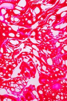 Abstraktes pinkfarbenes spinnennetz im öl