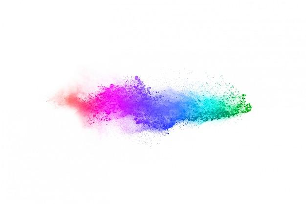 Abstraktes pulver bespritzt hintergrund. bunte pulverexplosion auf weißem hintergrund.