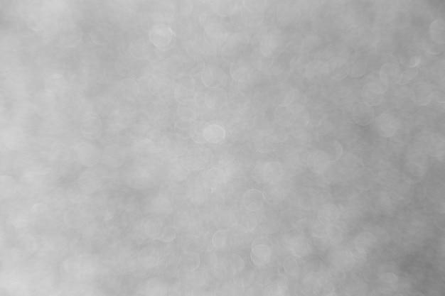 Abstraktes silbernes bokeh für weihnachtshintergrund, feierkonzept.