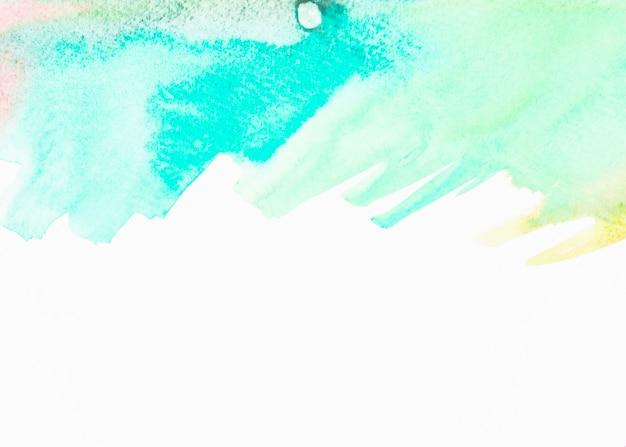 Abstraktes türkisaquarell auf weißem hintergrund