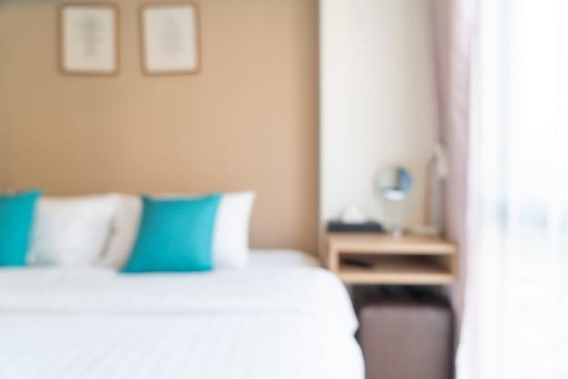 Abstraktes unschärfebett im schlafzimmer für den hintergrund
