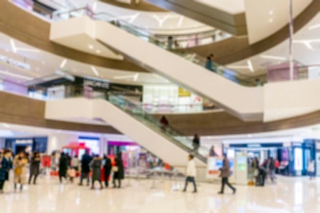 Abstraktes unschärfeeinkaufszentrum des kaufhausinnenraums für hintergrund