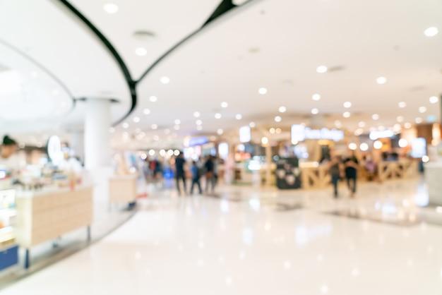 Abstraktes unschärfeeinkaufszentrum oder kaufhausinnenraum