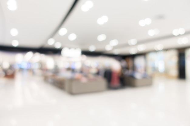 Abstraktes unschärfeeinkaufszentrum und einzelhandelsgeschäft