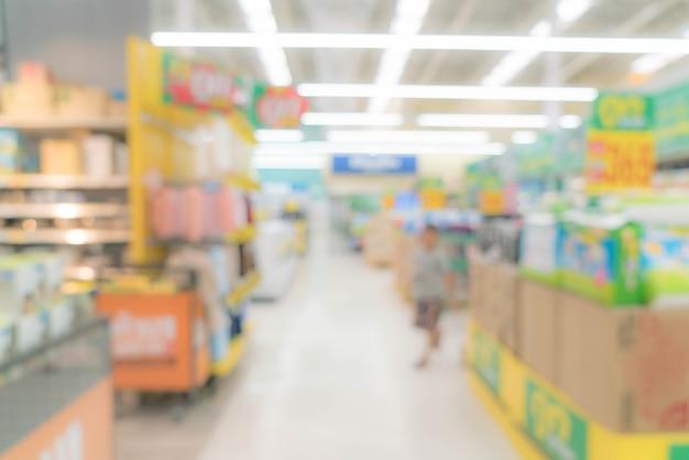 Abstraktes unschärfen-einkaufszentrum und einzelhandelsgeschäft innenraum