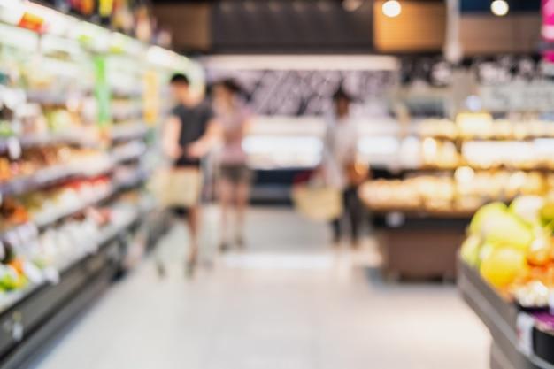 Abstraktes unscharfes bild des supermarktgeschäfts