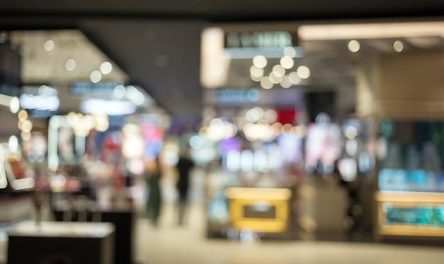Abstraktes verschwommenes einkaufszentrum für kunden