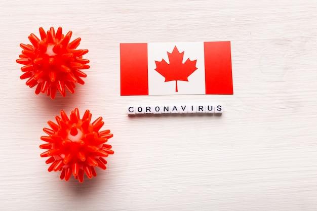 Abstraktes virusstammmodell des atmungssyndroms coronavirus 2019-ncov im nahen osten oder des coronavirus covid-19 mit text und flagge kanada auf weiß