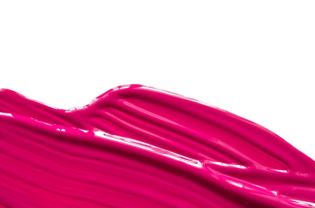 Abstrich und textur von rosa lippenstift oder acrylfarbe isoliert auf weißer oberfläche.