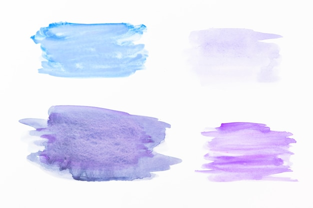 Abstriche von blauem und violettem aquarell