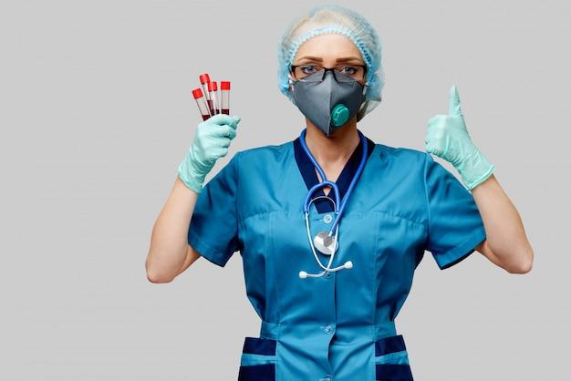 Ärztin der krankenschwester, die schutzmaske und handschuhe trägt und virusblut-reagenzglas hält