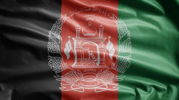 Afghanische flagge, die im wind weht