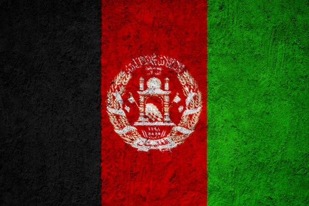 Afghanistan-flagge auf der schmutzbetonmauer