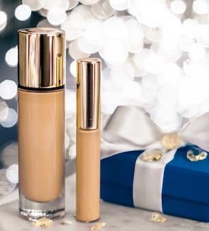 Ake-up foundation base, concealer und blaue geschenkbox