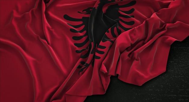 Albanien-flagge geknittert auf dunklem hintergrund 3d render