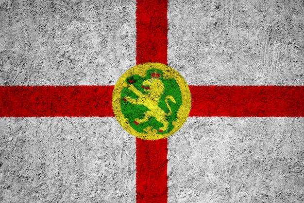 Alderney-flagge auf grunge-wand gemalt