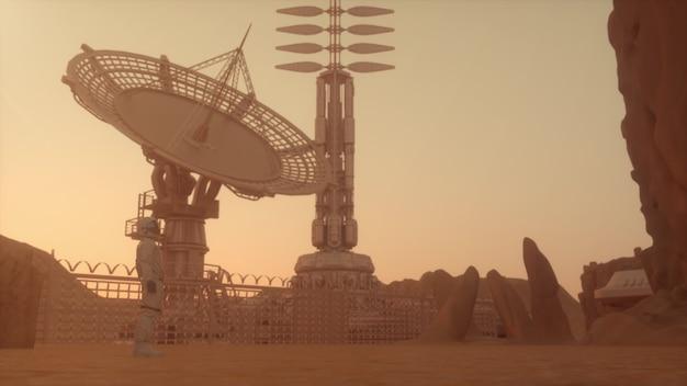 Alleine astronaut auf dem planeten mars, mit blick auf die basis in der wüstenlandschaft