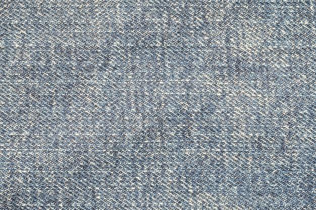 Alte baumwollstoffoberflächenhose der nahaufnahme gemasert