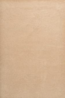 Alte benutzte papierblattbeschaffenheit. leerer brauner kraftpapierhintergrund