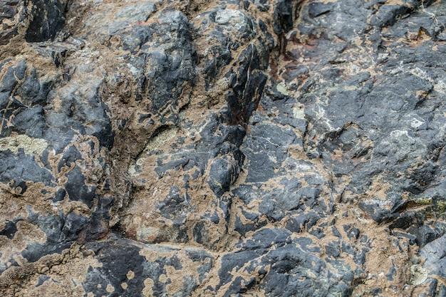 Alte bergsteine neigen texturhintergrund