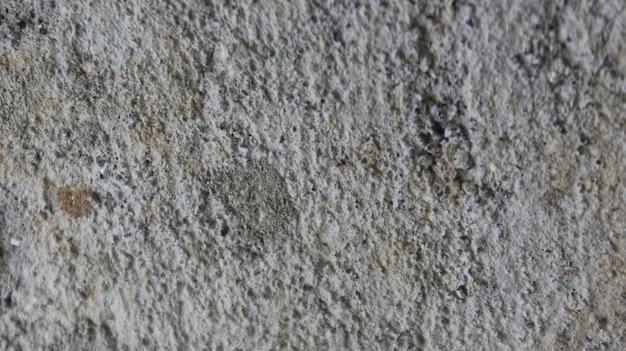 Alte betonwand in schwarz-weiß-farbe und braun